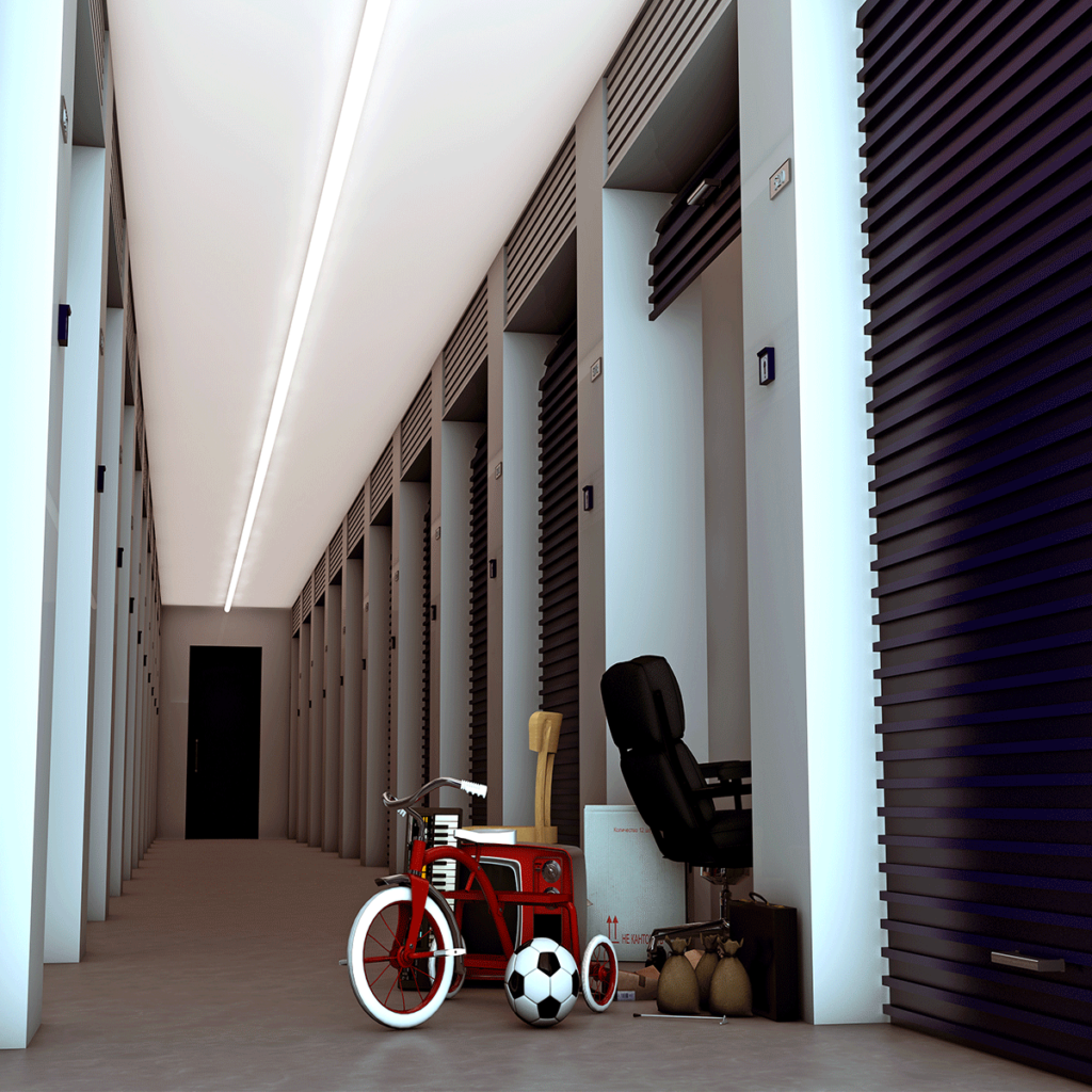 inside of a climate control storage facility hallway, with one unit open with a tricycle and other items sitting just outside of the open door